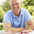 Man Enjoying Meal In Garden — Stock Photo #4840242