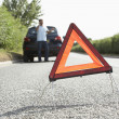 Driver Broken Down On Country Road With Hazard Warning Sign In F — Stock Photo