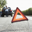Couple Broken Down On Country Road With Hazard Warning Sign In F — Stock Photo #4840249