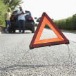 Couple Broken Down On Country Road With Hazard Warning Sign In F — Stock Photo #4840250