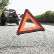 Stock Photo: Mother And Daughter Broken Down On Country Road With Hazard Warn