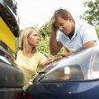 Stock Photo: Man And Woman Having Argument After Traffic Accident