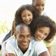 Portrait of Happy Family Piled Up In Park — Stock Photo #4840339