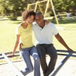 Young Couple Riding On Roundabout In Park — Stock Photo #4840373