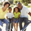 Family In Park Riding On Roundabout — Stock Photo #4840376