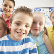 Group Of Primary Schoolchildren In Classroom — Stock Photo