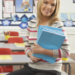 Portrait Of Female Teacher Sitting At Desk In Classroom — Stockfoto