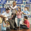 Teachers Playing Guitar With Pupils Having Music Lesson In Class — Stock Photo