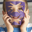 Male Primary School Pupil Cutting Out Paper Shapes In Craft Less - Stock Photo