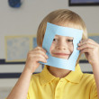 Male Primary School Cutting Out Paper Shapes In Craft Lesson — Stock Photo