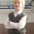 Portrait Of Male Primary School Pupil Standing In Classroom — Stock Photo