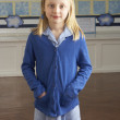 Stock Photo: Portrait Of Female Primary School Pupil Standing In Classroom