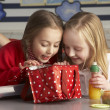Stock Photo: Primary School Pupils Enjoying Packed Lunch In Classroom