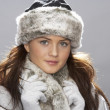 Young Woman Wearing Warm Winter Clothes And Fur Hat  In Stu - Stok fotoraf