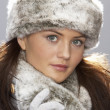 Young Woman Wearing Warm Winter Clothes And Fur Hat  In Stu — Stock Photo
