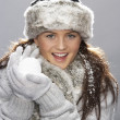 Young Woman Wearing Warm Winter Clothes And Fur Hat  In Stu - Stockfoto