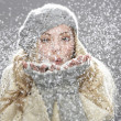 Teenage Girl Wearing Warm Winter Clothes And Hat Holding Snow In Studio - Stock Photo