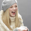 Teenage Girl Wearing Warm Winter Clothes And Hat Holding Snow In Studio - Foto de Stock