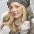 Fashionable Teenage Girl Wearing Cap And Fur Coat In Studio With Snow — Stock Photo