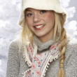 fashionable teenage girl wearing cap and knitwear in studio in front of chr — Stock Photo