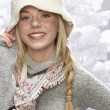 Fashionable Teenage Girl Wearing Cap And Knitwear In Studio In Front Of Chr - Foto Stock