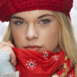 Fashionable Teenage Girl Wearing Cap And Knitwear In Studio In Front Of Chr - Stok fotoğraf