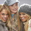 Three Fashionable Teenage Girls Wearing Cap And Knitwear In Studio — Stock Photo