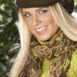 Fashionable Woman Wearing Knitwear And Scarf In Studio In Front Of Christma - Foto Stock