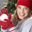Fashionable Teenage Girl Wearing Cap And Knitwear Holding Snowball In Studi - Stockfoto