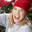 Fashionable Teenage Girl Wearing Cap And Knitwear Holding Snowball In Studi - Stok fotoğraf