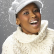 Fashionable Woman Wearing Knitwear And Cap In Studio In Front Of Christmas — Stock Photo