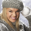 Fashionable Woman Wearing Cap And Knitwear Holding Snowball In Studio In Fr — Stock Photo