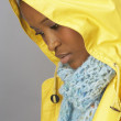 Young Woman Wearing Yellow Raincoat In Studio — Foto de Stock