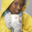 Young Woman Drinking Hot Drink Wearing Yellow Raincaot — Stock Photo
