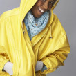 Young Woman Wearing Yellow Raincoat In Studio — Stock Photo