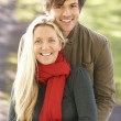 Portrait Of Romantic Young Couple In Autumn Park — Stock Photo