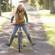 Portrait Of Young Woman With Cycle In Autumn Park — Stock Photo