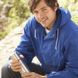 Young Man Relaxing With Thermos Flask In Autumn Landscape — Stock Photo