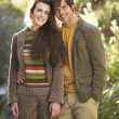 Portrait Of Romantic Young Couple In Autumn Landscape — Foto de Stock