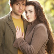 Portrait Of Romantic Young Couple In Autumn Landscape — Stok fotoğraf