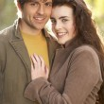 Portrait Of Romantic Young Couple In Autumn Landscape — Stock Photo