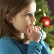 Young Girl Standing In Front Of Christmas Tree — Foto Stock