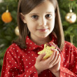 Young Girl Eating Reindeer Shaped Christmas Cookie — 图库照片