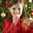 Young Girl Eating Reindeer Shaped Christmas Cookie — ストック写真