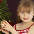 Young Girl Decorating Christmas Tree — 图库照片