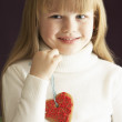 Royalty-Free Stock Photo: Young Holding Heart Shaped Cookie In Studio