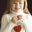 Young Holding Heart Shaped Cookie In Studio — Stock Photo