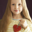 Stock Photo: Young Holding Heart Shaped Cookie In Studio