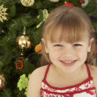 Young Girl Standing In Front Of Christmas Tree — Stok fotoğraf
