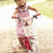Girl Learning To Ride Bike Wearing Safety Helmet — Stock Photo